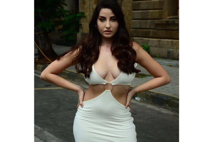 Nora looking hot in a white cut-out bodycon dress with plunging neckline